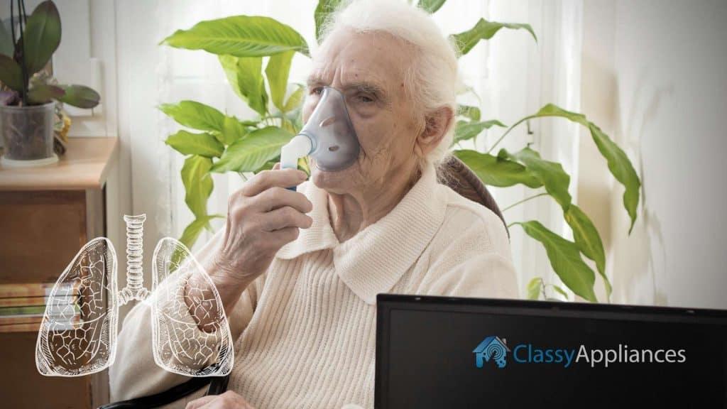 asthma problem old man taking inhaler